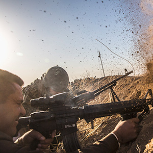 Kurdish pesh merga troops fire at Islamic State positions as they move toward the Iraqi town of Badana Pichwk on Monday morning, Oct. 17, 2016. Kurdish forces began Monday advancing on a string of villages east of Mosul, the start of a long-awaited campaign to reclaim Iraq's second-largest city from the Islamic State, which seized it more than two years ago, officials said. (Bryan Denton/The New York Times/Redux)