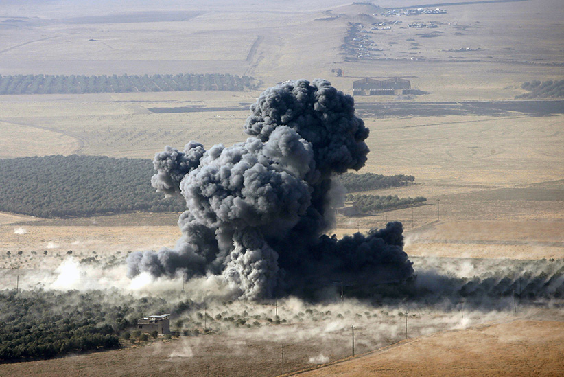 Smoke rises at Islamic State militants' positions in the town of Naweran, near Mosul, Iraq, October 23, 2016. (Azad Lashkari/Reuters)