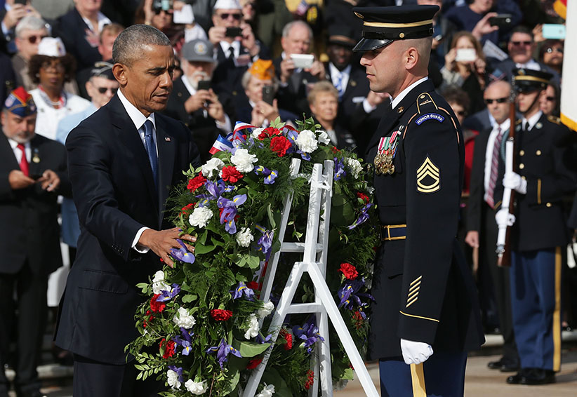 U.S. President Barack Obama participates in a wreath-laying ceremony at the Tomb of the Unknown Soldier at Arlington National Cemetery on Veterans Day November 11, 2016 in Arlington, Virginia. The annual Veterans Day National Ceremony was held at the cemetery to honour Americans who had served in the U.S. Armed Forces.  (Alex Wong/Getty Images)