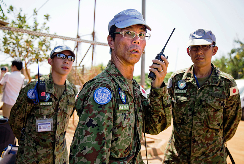 Members of the Japanese Ground Self-Defence Force (GSDF) prepare the arrival of new troops at the compound of the United Nations peacekeeping mission (UNMISS) upon their arrival in Juba, South Sudan, on November 21, 2016. A United Nations plane landed in the morning at Juba airport with 60 new Japanese peacekeepers as the first group of the 350-strong unit, which will replace the current Japanese troops at the UN mission in South Sudan. The group, mostly engineers, will construct roads and facilities and are also assigned for the first time under Japans new security law, which enables GSDF troops to use weapons to rescue UN staff under attack. (Albert Gonzalez Farran/AFP/Getty Images)