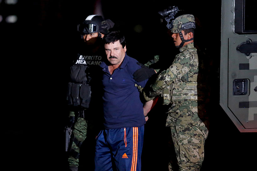 "Joaquin ""El Chapo"" Guzman is escorted by soldiers during a presentation in Mexico City, January 8, 2016. (Tomas Bravo/Reuters)"
