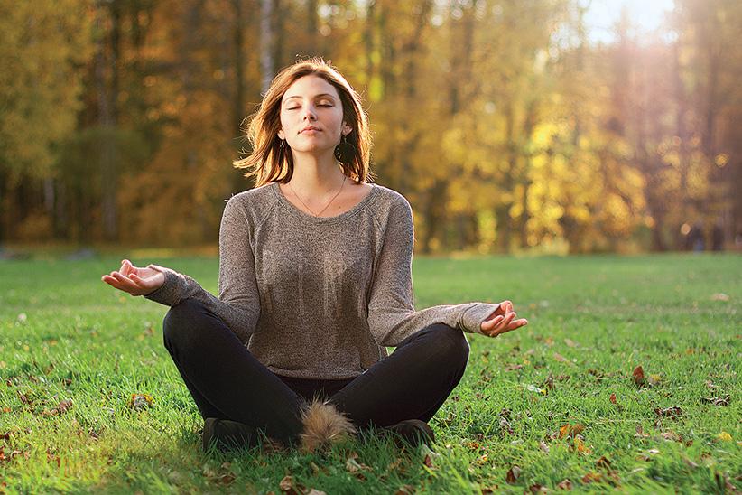 Girl meditates (Shutterstock)