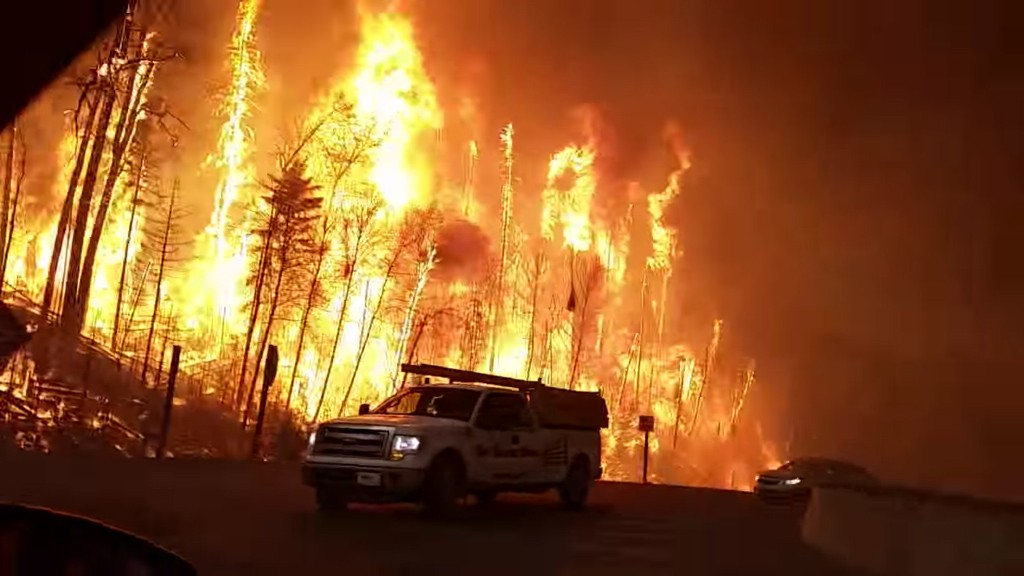 May 9, 2016: For many, the harrowing trip out of the burning town involved getting very close to the fire in Fort McMurray. (Jason Edmondson)