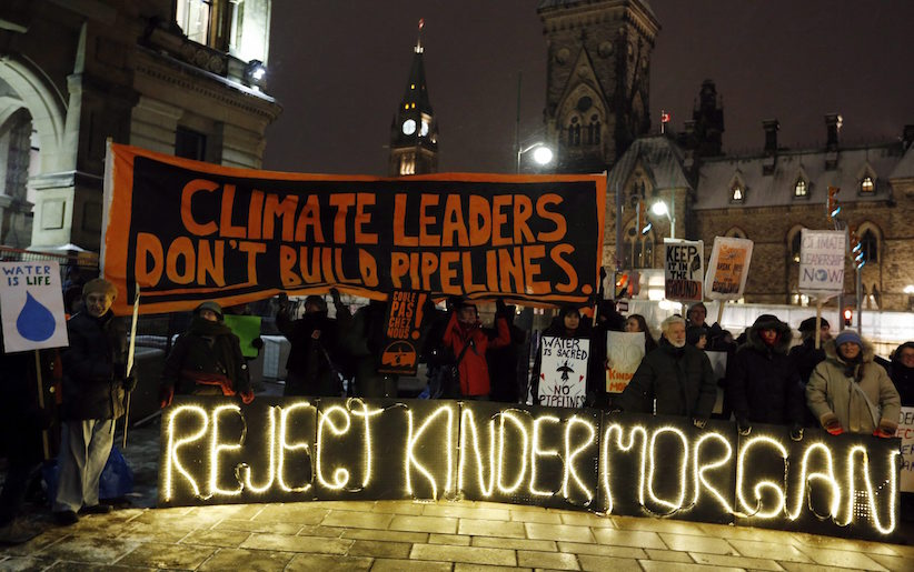 People protest against the proposed Kinder Morgan pipeline outside Prime Minister Justin Trudeau's office, below Parliament Hill on November 21, 2016. THE CANADIAN PRESS/Fred Chartrand
