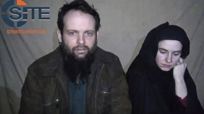 This undated militant file image from video posted online in August 2016, which has not been independently verified by The Associated Press, provided by SITE Intel Group, shows Canadian Joshua Boyle and American Caitlan Coleman, who were kidnapped in Afghanistan in 2012. The parents of a Canadian man held hostage in Afghanistan say a recently released video of their son and his family marks the first time they've seen their two grandchildren, who were born in captivity. THE CANADIAN PRESS/ AP-SITE Intel Group via AP, File