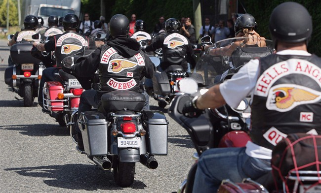 Quebec members of the Hell's Angels motorcycle gang arrive at the White Rock, B.C., chapter's property in Langley, B.C., on Friday July 25, 2008. (Darryl Dyck/CP)