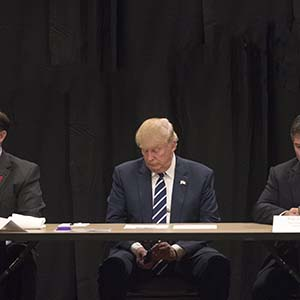 Donald Trump is interrupted by a phone call during a meeting with specialists on the problem of opiate addiction, after a campaign event in Manchester, N.H., Oct. 28, 2016. Trump on Friday seized on the FBI's announcement that it had uncovered new emails related to the investigation into whether Hillary Clinton had mishandled classified information. (Stephen Crowley/The New York Times/Redux)