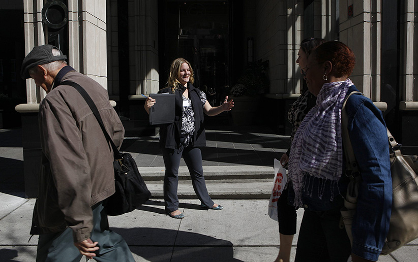 Canvaser Emily Smits, in the black vest, solicits donations on the street in Toronto. (Deborah Baic/Globe and Mail/CP)