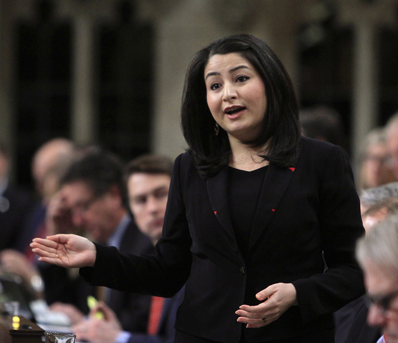 Maryam Monsef Minister of Demcratic Institutions stands in the House of Commons during question period in Ottawa, Friday, December 2, 2016. (FRED CHARTRAND/CP)