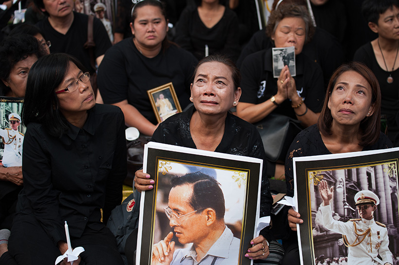 Thai mourners hold portraits of late Thai King Bhumibol Adulyadej at Siriraj Hospital in Bangkok, Thailand on November 13, 2016. Thousands of Thai mourners took part in a vigil 30 days after the death of late Thai King Bhumibol Adulyadej. King Bhumibol, the world's longest reigning monarch died at the age of 88 in Siriraj hospital on 13 October 2016. (Anusak Laowilas/NurPhoto/Getty Images)