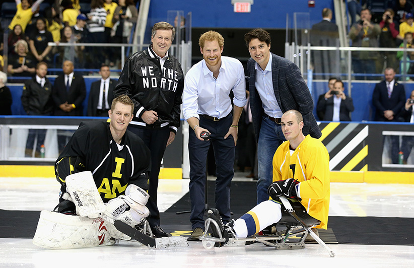 Prince Harry drops the puck as Canadian Prime Minister Justin Trudeau looks on as they start a sledge-hockey match Mattany at the Athletic Centre on May 2, 2016 in Toronto, Canada. Prince Harry was in Toronto for the Launch of the 2017 Toronto Invictus Games before heading down to Miami and the 2016 Invictus Games in Orlando.  (Chris Jackson/Getty Images)
