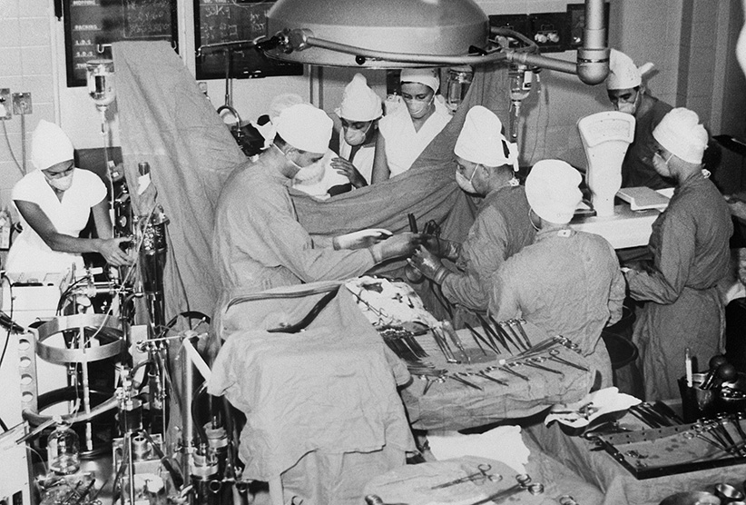 View of members of Dr. Christiaan Barnard's surgical team performing an open heart surgery in the theater where the now famous Washkansky heart transplant operation was carried out December 3rd in the Groote Schuur Hospital. (Bettmann/Getty Images)