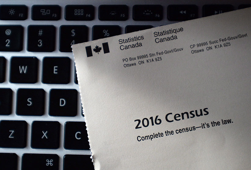 A Statistics Canada 2016 Census sits on the key board of a laptop after arriving in the mail at a home in Ottawa on Monday, May 2, 2016. (Sean Kilpatrick/CP)