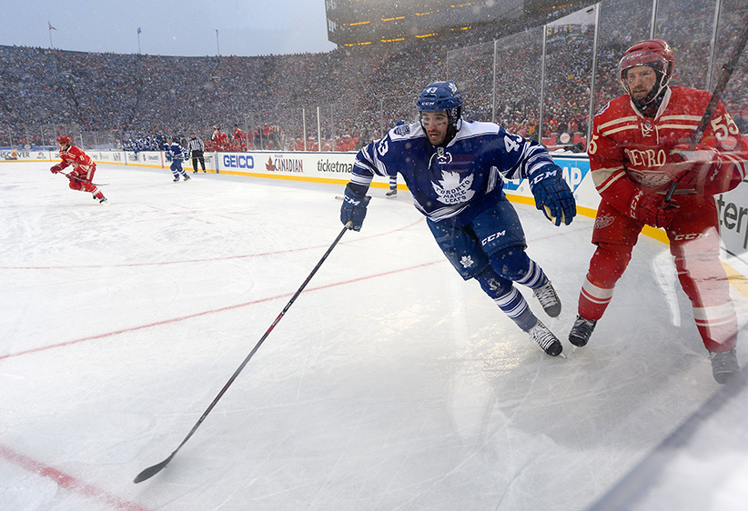 Nazem Kadri #43 of the Toronto Maple Leafs and Niklas Kronwall #55 of the Detroit Red Wings skate in the corner in the overtime during the 2014 Bridgestone NHL Winter Classic on January 1, 2014 at Michigan Stadium in Ann Arbor, Michigan. (Brian Babineau/NHLI/Getty Images)