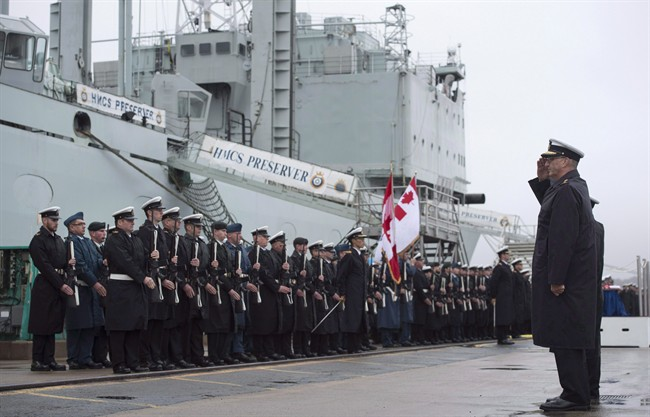 Rear-Admiral John Newton, right, Commander Maritime Forces Atlantic, salutes the crew of HMCS Preserver during the ship's paying-off ceremony at HMC Dockyard in Halifax on Friday, October 21, 2016. National Defence and Parliament's budget watchdog have been quietly battling over access to key information about the government's multi-billion-dollar plan to buy the navy new warships. THE CANADIAN PRESS/Darren Calabrese
