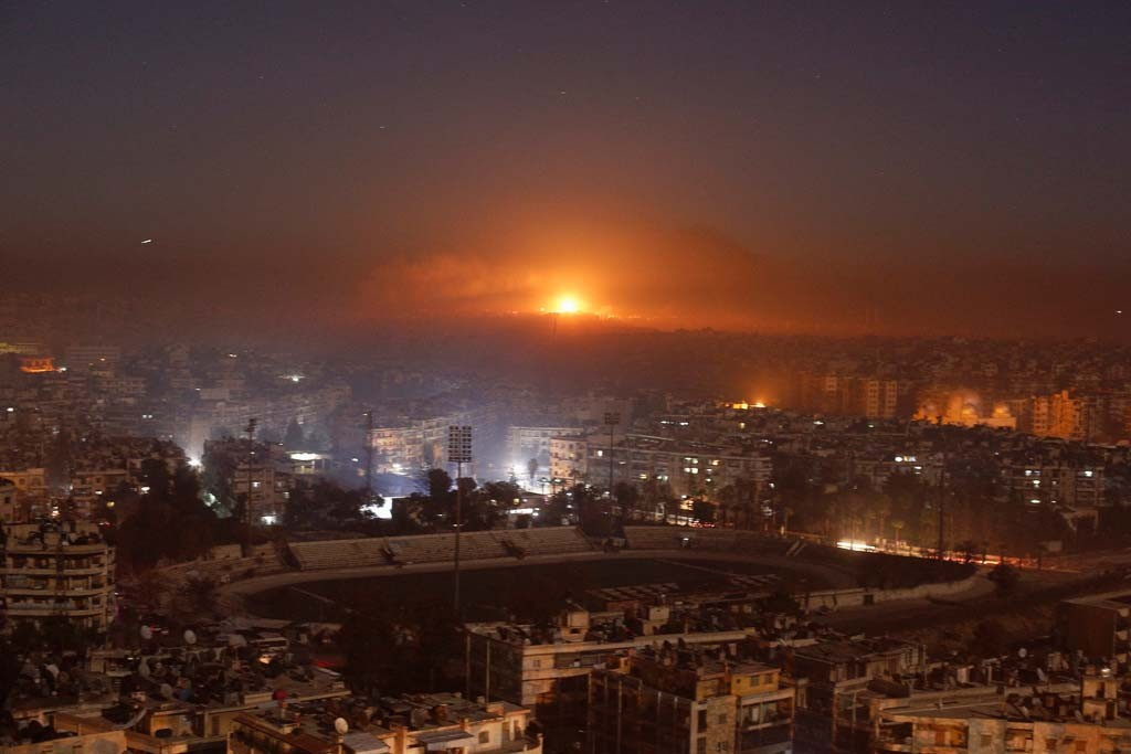 Smoke and flames rise after air strikes on rebel-controlled besieged area of Aleppo, as seen from a government-held side, in Syria December 11, 2016. (Omar Sanadiki/Reuters)