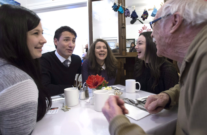 Prime Minister Justin Trudeau speaks with locals as he visits a restaurant in Manotick, Ont. Thursday January 12, 2017. (Adrian Wyld/CP)