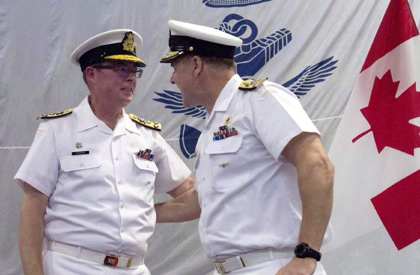 Royal Canadian Navy Vice-Admiral Mark Norman (left) speaks with Vice-Admiral Ron Lloyd during a change of command ceremony, Thursday, June 23, 2016 in Ottawa. Norman, one of the military's highest ranking officers, has been temporarily removed from his post. (Adrian Wyld/CP)