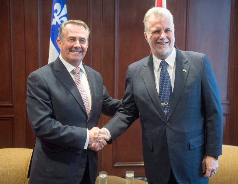 Quebec Premier Philippe Couillard, right, greets British Secretary of State for International Trade Liam Fox before their meeting Friday, January 27, 2017 in Montreal. (Ryan Remiorz/CP)