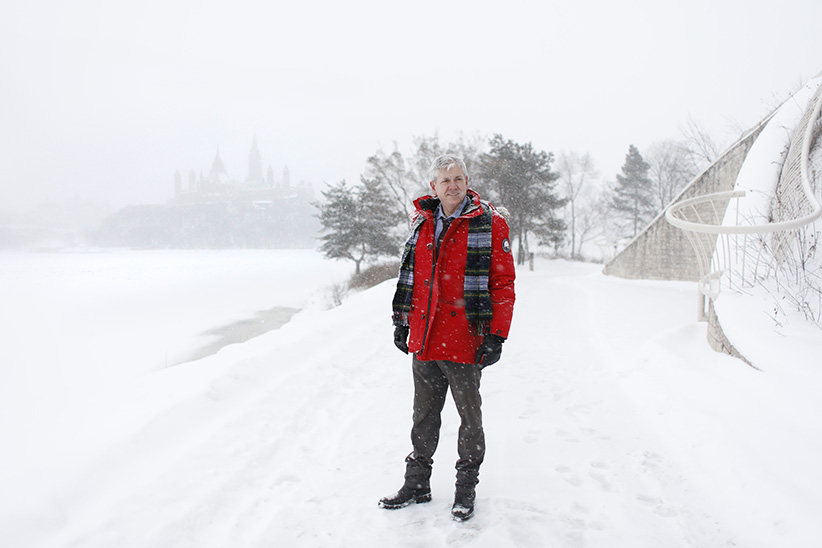 NDP leadership hopeful Charlie Angus in a snow storm, with the shadow Parliament Hill behind him, in Gatineau December 17, 2016. (Photograph by Blair Gable)