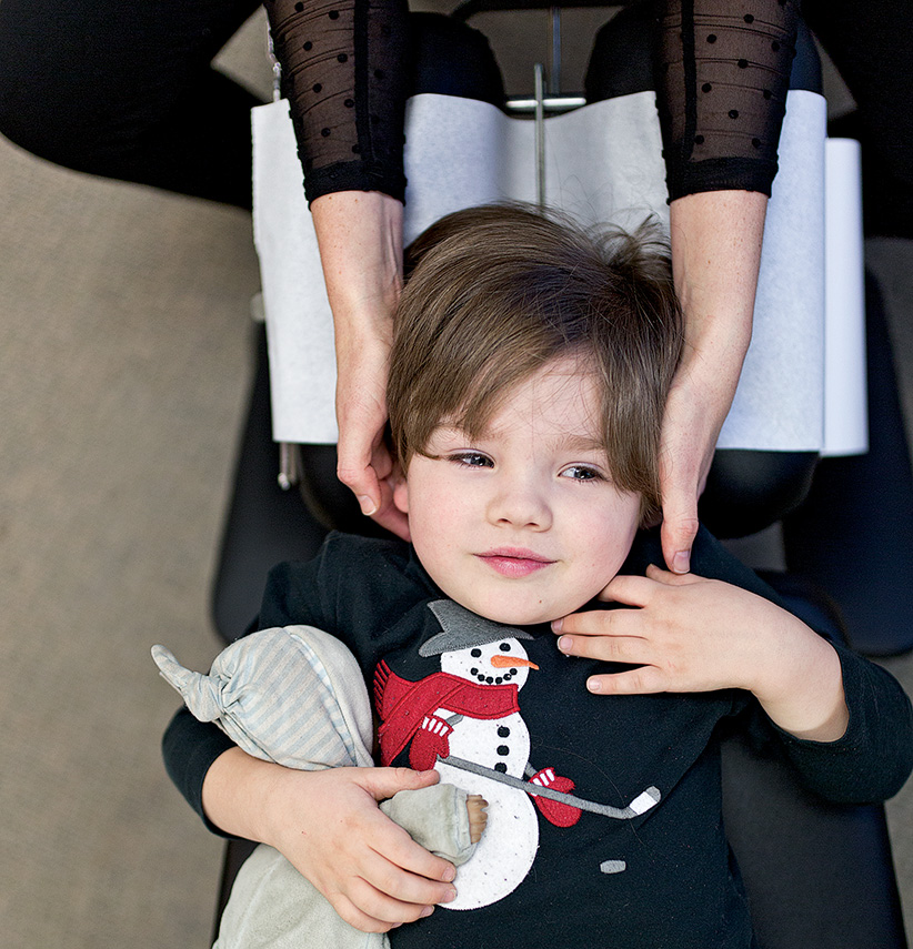 Four-year-old Cooper Fredrick has an adjustment from chiropractor Dr. Jennifer Wise. (Photograph by Nick Iwanyshyn)