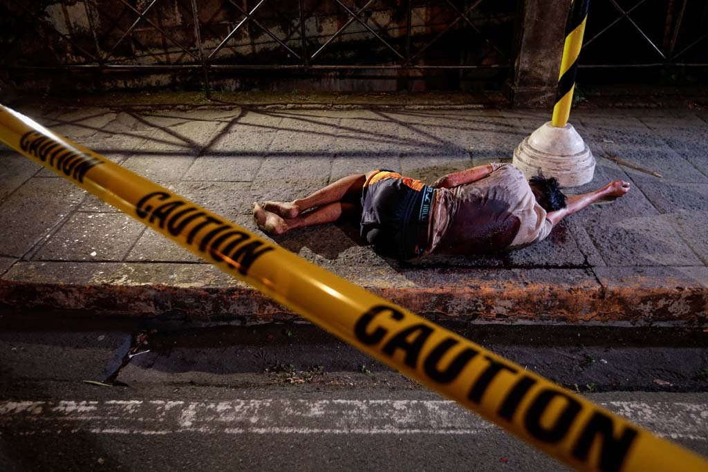 Killed in Duerte's war A man lies in a Manila street after being killed, allegedly in the 'anti-drug' crackdown led by President Rodrigo Duterte(Mark R. Cristino/EPA)