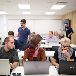 Students working on their computers at Laurentian University. (Photograph by Nick Iwanyshyn)