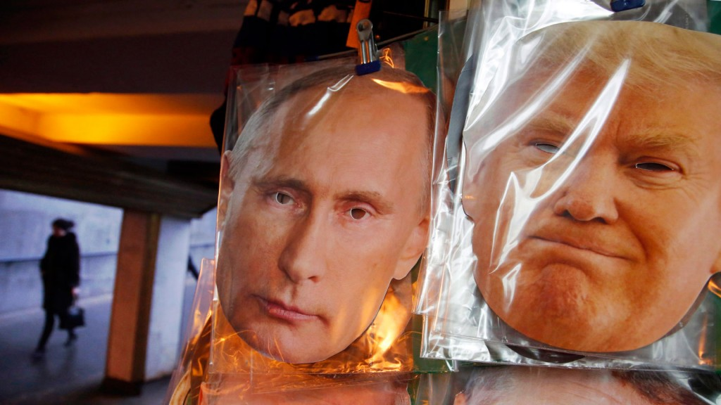 Face masks depicting Russian President Vladimir Putin and U.S. President-elect Donald Trump hang for sale at a souvenir street shop in St.Petersburg, Russia, Friday, Dec. 23, 2016. (Dmitri Lovetsky/AP/CP)