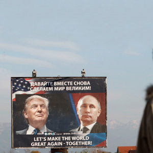 A woman passes a billboard showing a pictures of US president-elect Donald Trump and Russian President Vladimir Putin in Danilovgrad, Montenegro, November 16, 2016. (Stevo Vasiljevic/Reuters)