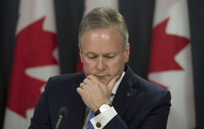 Bank of Canada Governor Stephen Poloz listens during a news conference in Ottawa, Wednesday, January 18, 2017. The central bank announced that it would maintain its target for the overnight interest rate at 0.5 per cent. THE CANADIAN PRESS/Adrian Wyld