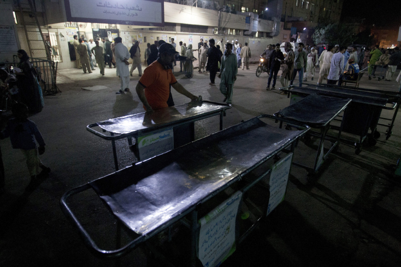 Pakistani hospital staff make arrangements outside an emergency ward for the victims of suicide bombing at a famous shrine in interior Sind province, in Karachi, Pakistan. Thursday, Feb. 16, 2017. An Islamic State suicide bomber targeted worshippers at a famous shrine in southern Pakistan on Thursday, killing dozens of people and wounding others, officials said. (Shakil Adil/AP)