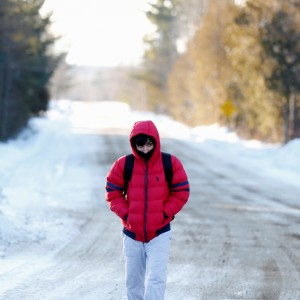 A man who said his name was Abdullah and that he was a student from Yemen walks towards the U.S.-Canada border to cross into Hemmingford, Canada, from Champlain in New York, U.S., February 17, 2017.  (Christinne Muschi/Reuters)