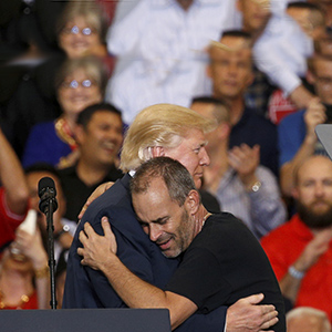 "U.S. President Donald Trump hugs a supporter he invited onstage to speak during a ""Make America Great Again"" rally at Orlando Melbourne International Airport in Melbourne, Florida, U.S. February 18, 2017.  (Kevin Lamarque/Reuters)"