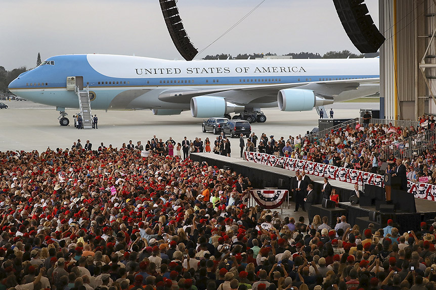 People listen as President Donald Trump speaks during a campaign rally at the AeroMod International hangar at Orlando Melbourne International Airport on February 18, 2017 in Melbourne, Florida. (Photo by Joe Raedle/Getty Images)