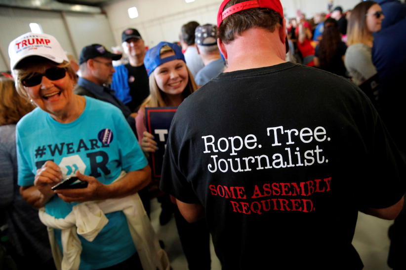 "A man wears a shirt reading ""Rope. Tree. Journalist."" as supporters gather to rally with Republican presidential nominee Donald Trump in a cargo hangar at Minneapolis Saint Paul International Airport in Minneapolis, Minnesota, U.S. November 6, 2016. (Jonathan Ernst/Reuters)"