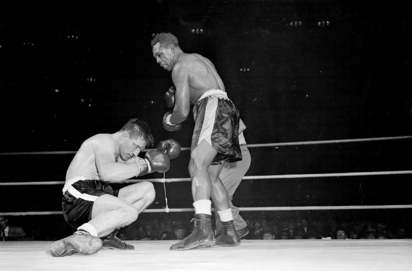 Canadian challenger Yvon Durelle is down in 11th round of Light-Heavyweight title fight just before losing to champion Archie Moore in Montreal, Quebec, Canada, Dec. 10, 1958. (AP/CP)