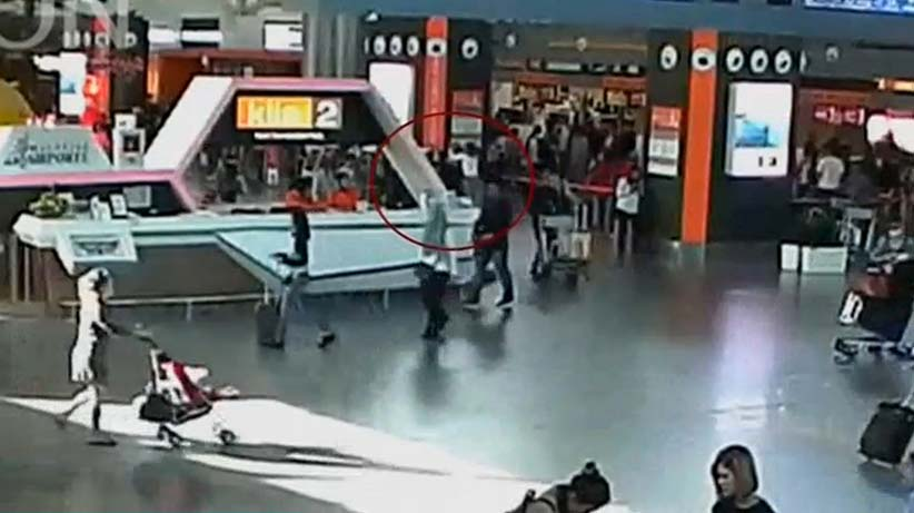 A still image from a CCTV footage appears to show (circled in red) a man purported to be Kim Jong Nam being accosted by a woman in a white shirt at Kuala Lumpur International Airport in Malaysia on February 13, 2017. (FUJITV/Reuters)