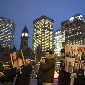 A small group of family and friends of Soleiman Faqiri, hold a vigil at Nathan Phillips Square, for the mentally ill man who died during an altercation with guards in jail in Lindsay about 8 weeks ago. (Rick Madonik/Toronto Star/Getty Images)