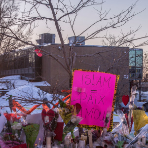Throughout the second day after the late-night shooting at the Mosque in Quebec city, people continued to add flowers and notes and other objects as memorials for the victims on snowbanks around the perimiter of the mosque. (Photograph by Roger LeMoyne)
