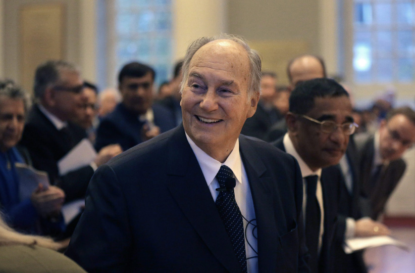 The Aga Khan, center, smiles as he arrives at the Memorial Church on the campus of Harvard University before addressing an audience. (Steven Senne/AP/CP)