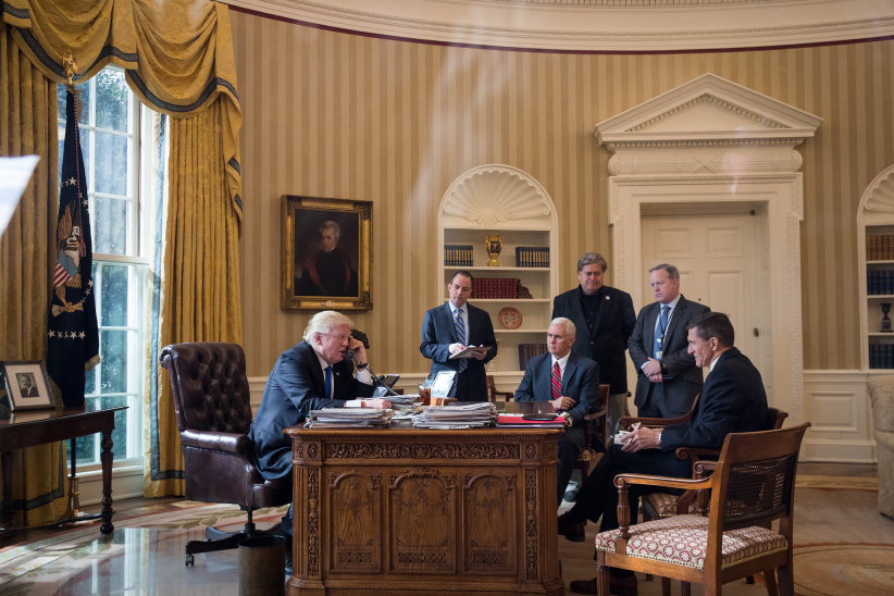 President Donald Trump speaks on the phone with Russian President Vladimir Putin in the Oval Office of the White House, January 28, 2017 in Washington, DC. Also pictured, from left, White House Chief of Staff Reince Priebus, Vice President Mike Pence, White House Chief Strategist Steve Bannon, Press Secretary Sean Spicer and National Security Advisor Michael Flynn. (Drew Angerer/Getty Images)