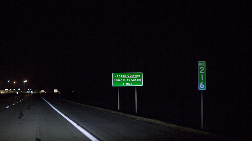 Heading toward Canada from Pembina, North Dakoka, where refugees get dropped off by cab drivers from Grand Forks, North Dakota. (Photograph by Nick Iwanyshyn)