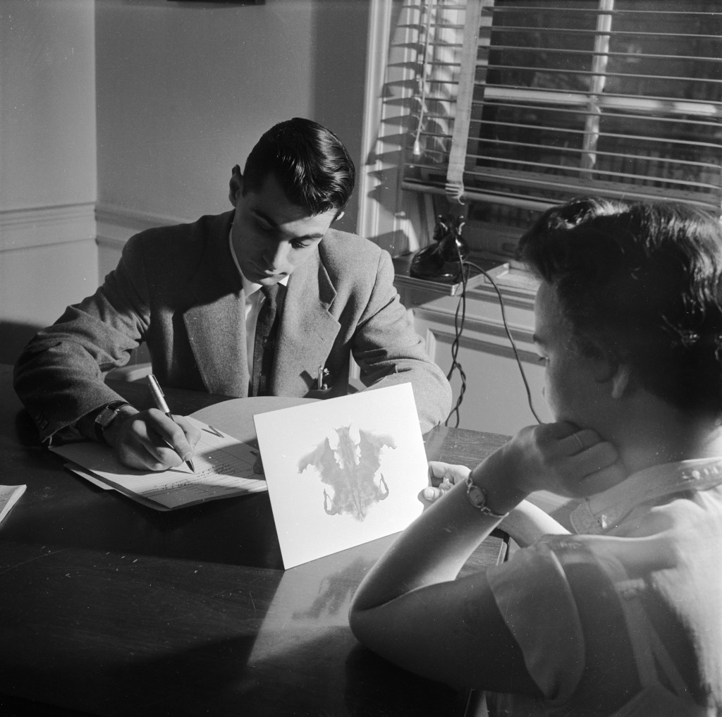 circa 1950: A doctor at the Headache Clinic in the Montefiore Hospital using the Rorschach personality test to determine whether the patient's headaches have a psychological origin. (Photo by Orlando /Three Lions/Getty Images)
