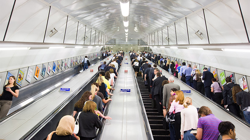 Rush hour commuters on London Underground escalators, UK. (Alex Segre/Getty Images)