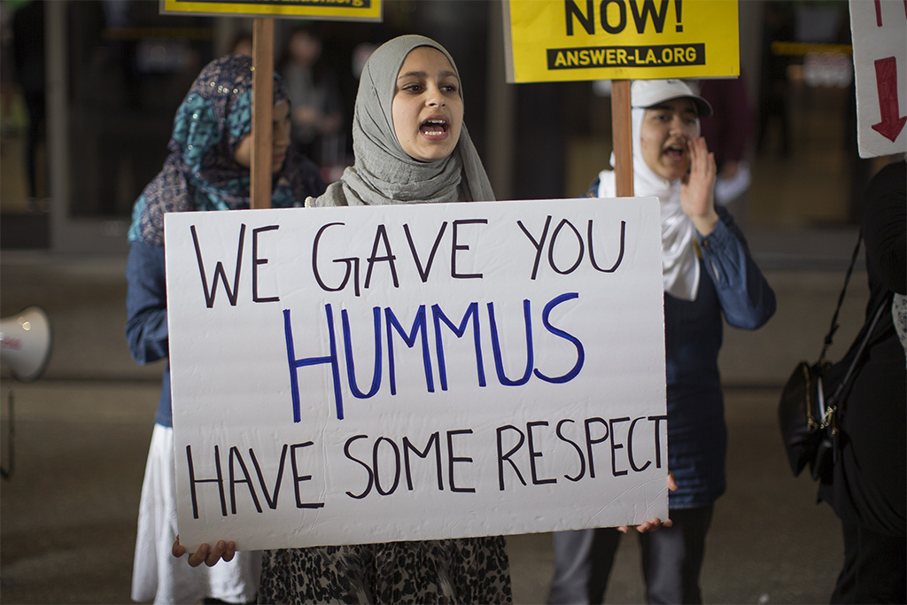 <p>Demonstrators support a ruling by a federal judge in Seattle that grants a nationwide temporary restraining order against the presidential order to ban travel to the United States from seven Muslim-majority countries, at Tom Bradley International Terminal at Los Angeles International Airport on February 4, 2017 in Los Angeles, California.</p>