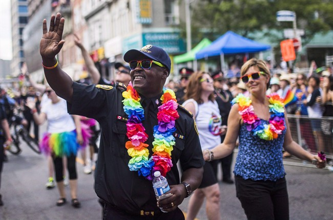 Toronto's police chief says he understands the LGBTQ community is divided and decided his force wouldn't participate in the city's parade to enable those differences to be addressed. Toronto police chief Mark Saunders marches during the annual Pride Parade in Toronto, in a July 3, 2016, file photo. THE CANADIAN PRESS/Mark Blinch