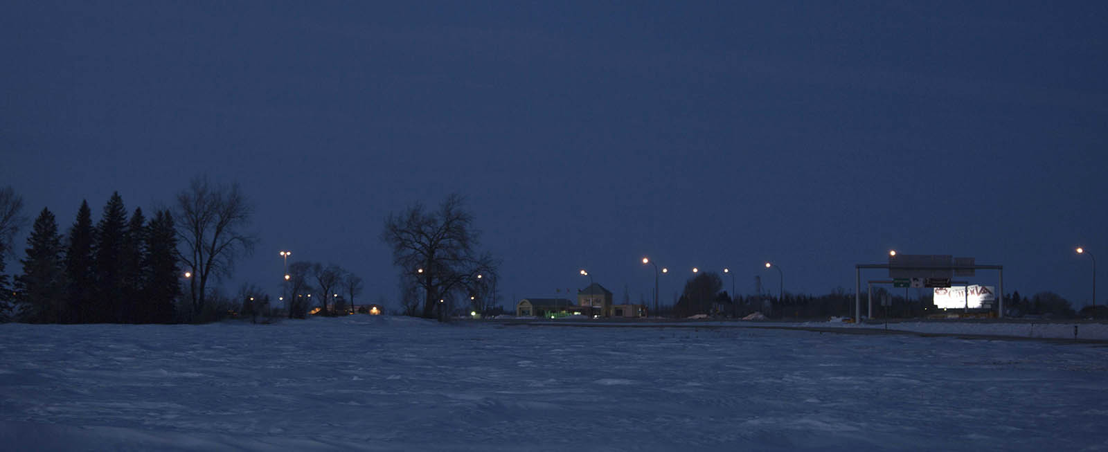 Lights along the highway from farmers fields in Emerson, Manitoba, west of the border. (Photograph by Nick Iwanyshyn)