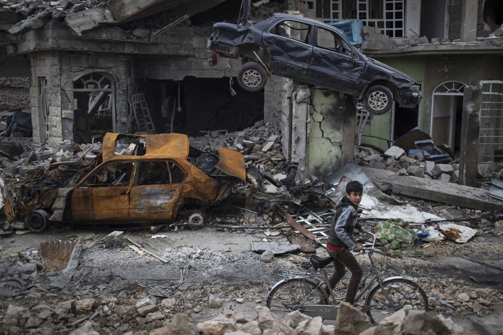 According to us deadly mosul airstrikes were at the request of an iraqi boy cycles through a war torn neighbourhood in western mosul felipe dana publicscrutiny Gallery