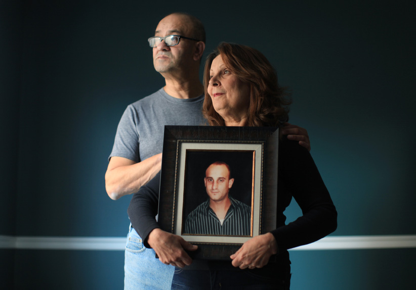 Nicole Nayel (right) and Amine Nayel hold a photograph of their son Fouad Nayel. Adam Picard, 33, was charged for the June 2012 killing of Fouad Nayel. Picard first-degree murder charge stayed after a four-year delay in the justice system. (Dave Chan)
