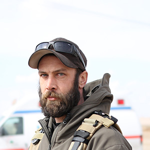 Alex Moreau, the 36- year old Vancouver native and the co-founder of MERMT outside the clinic south of Mosul that will serve as a frontline emergency medical response centre for civilians injured during phase 3 of the fight against ISIS.  Moreau began as a foreign fighter in Syria but realized that emergency medical services were more important than killing ISIS fighters. (Photograph by Adnan Khan)